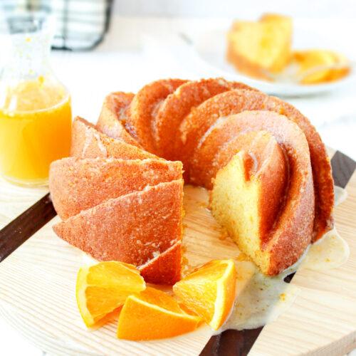 A sliced whole orange cake