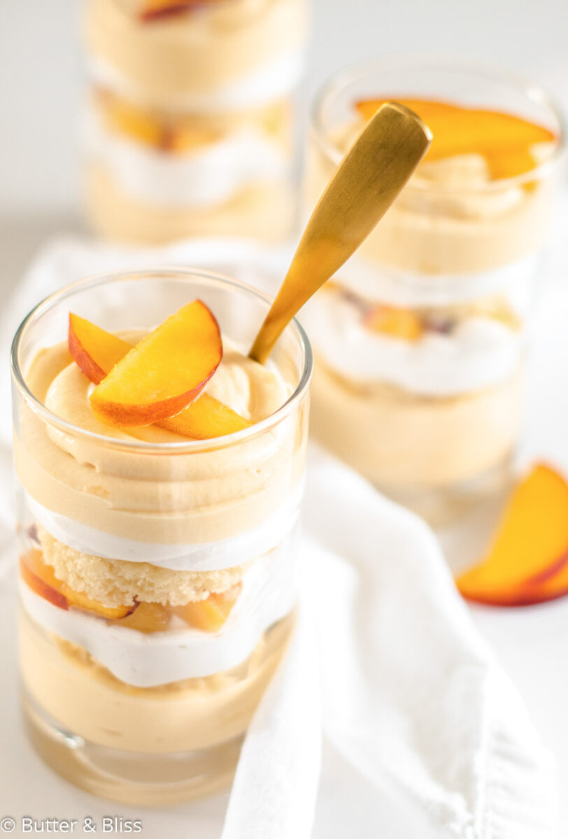 Close up of peaches and cream trifle in parfait glass