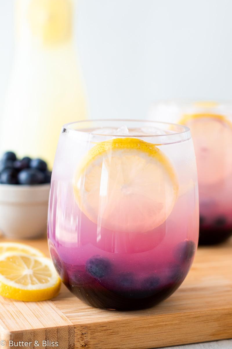 Single glass of blueberry lemonade