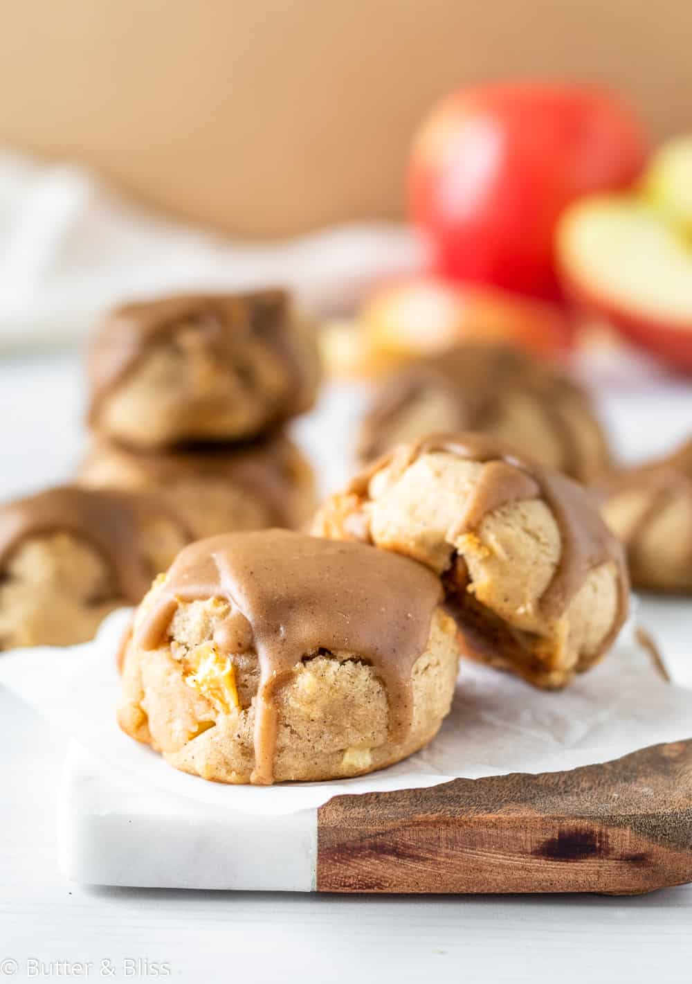 Soft apple cookie with caramel icing on a small plate