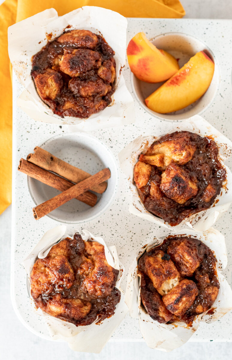 Freshly baked peach monkey bread muffins