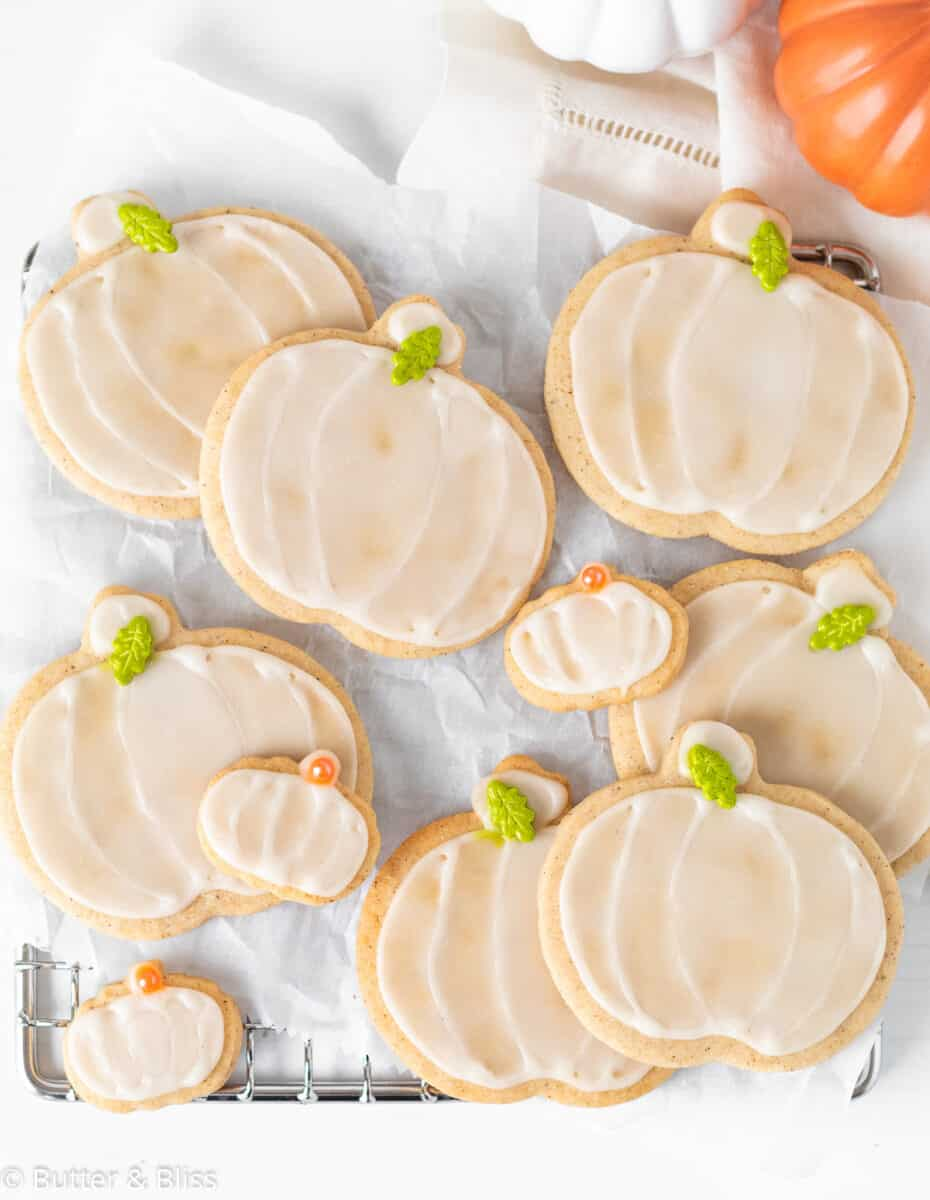 A tray of freshly decorated pumpkin spice sugar cookies