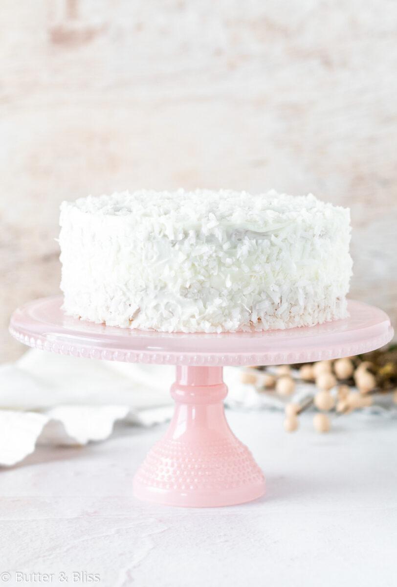 Mini almond cardamom coconut cake on cake stand