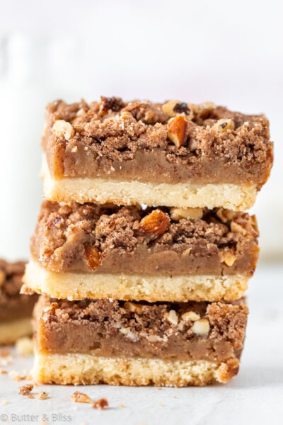 Stack of caramel nut crumble bars