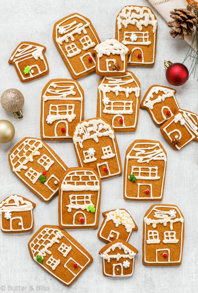 A platter of gingerbread house cookies with apple cider icing