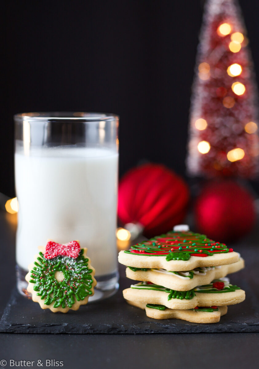 A glass of milk and stack of sugar cookies