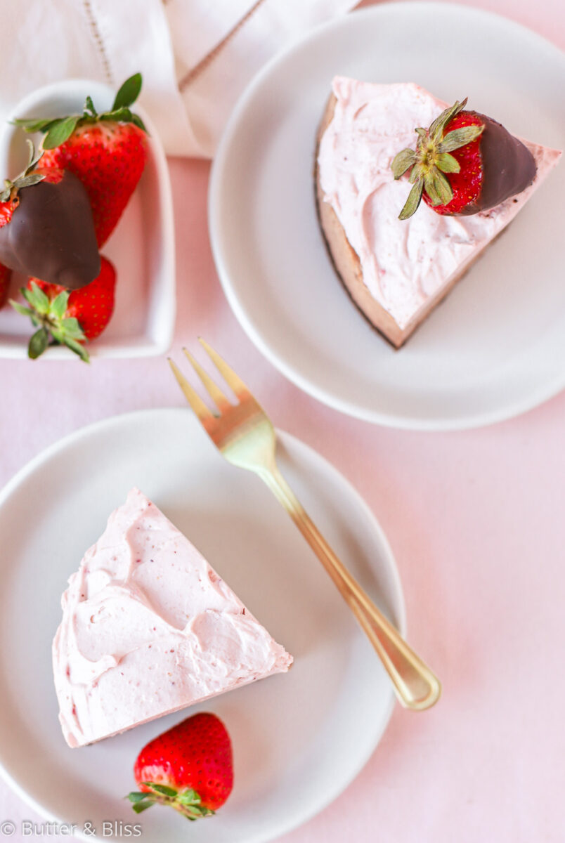 Slices of chocolate cake with strawberries