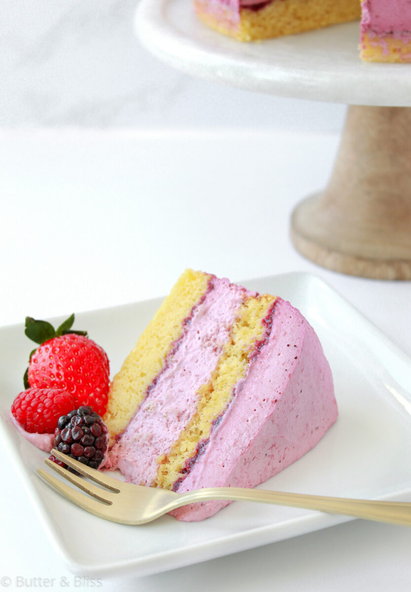 A slice of berry layer cake on a plate