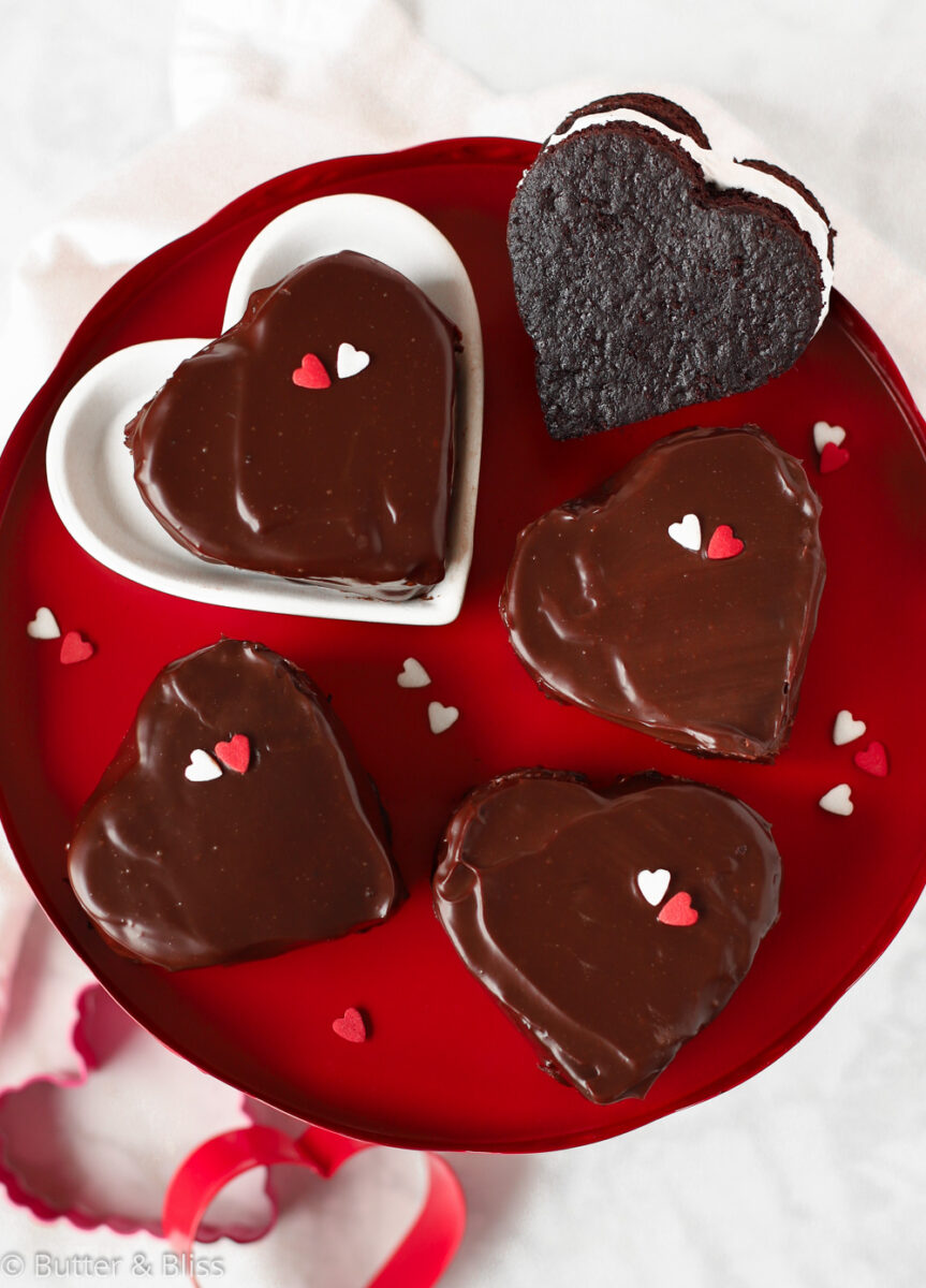 Red platter of chocolate coated mini cakes