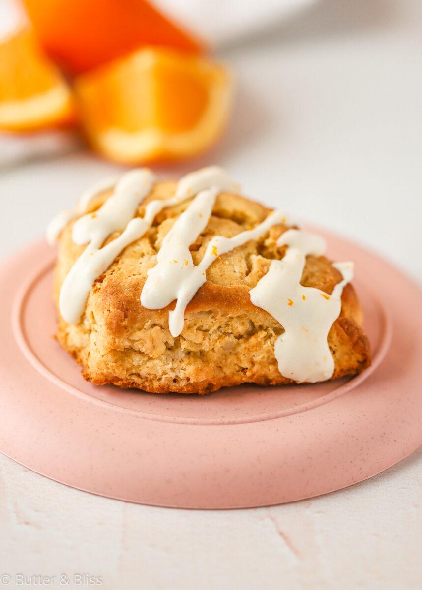 Iced orange scone on a plate