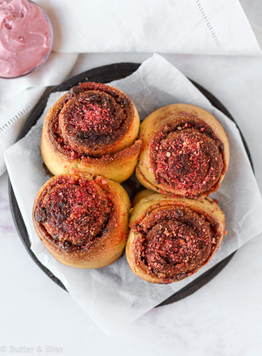 Four unfrosted chocolate strawberry cinnamon rolls