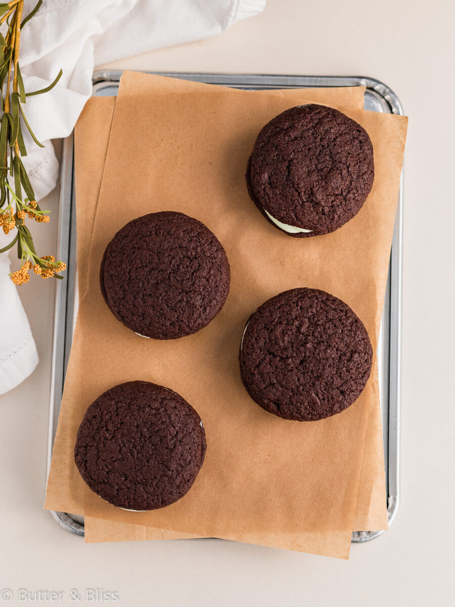 Chocolate whoopie pies on a baking sheet