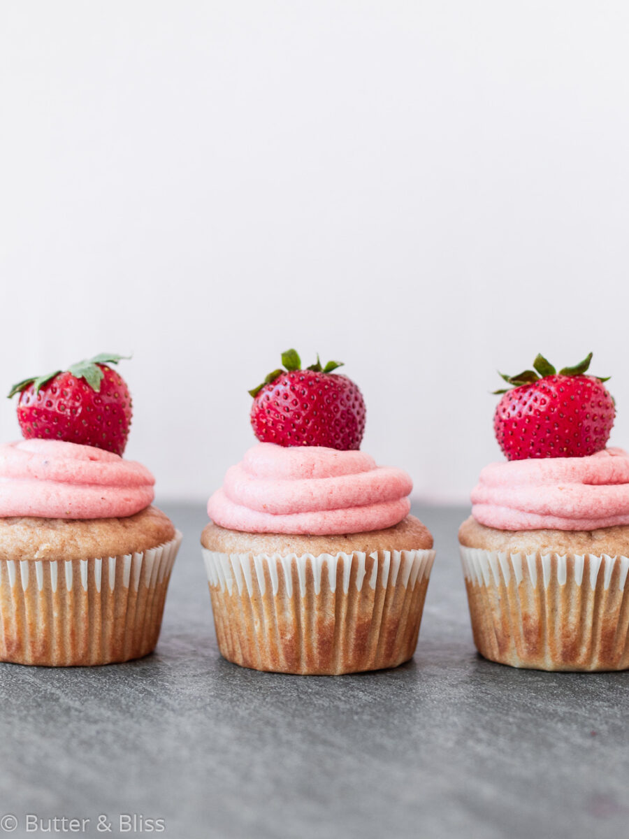 Cupcakes in a row on a table