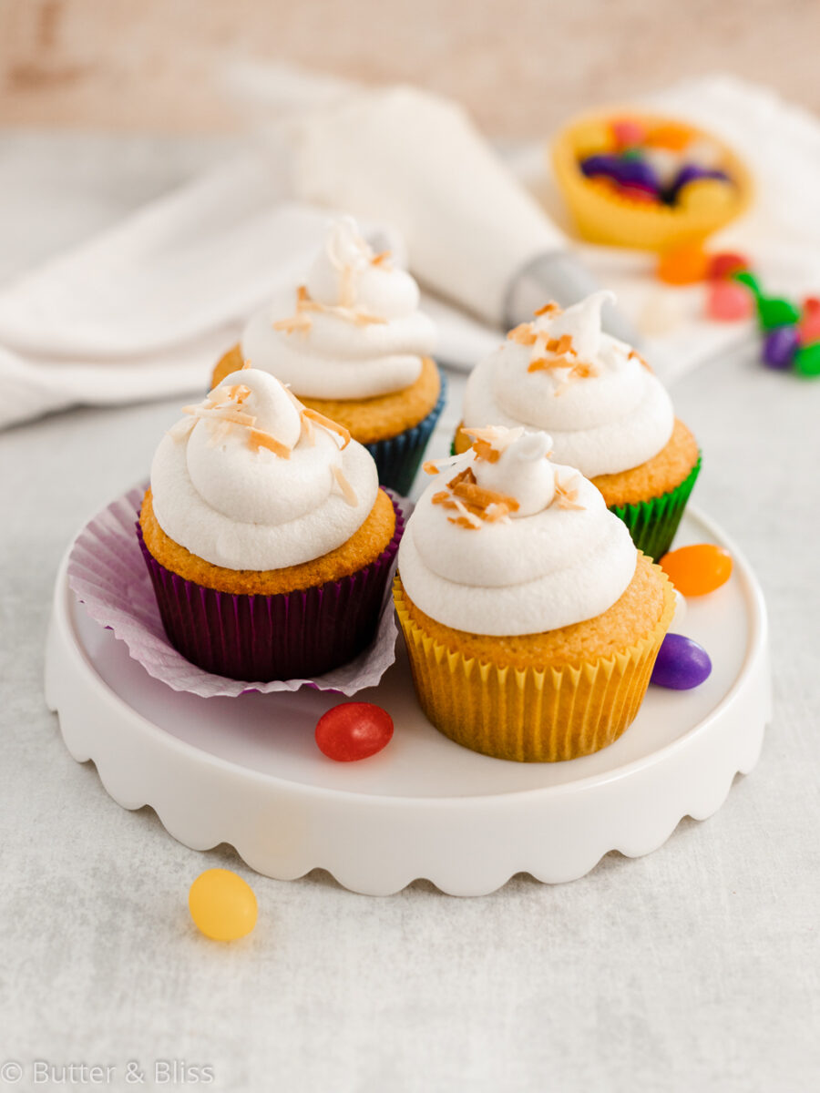 Frosted Easter cupcakes on a platter with jelly beans