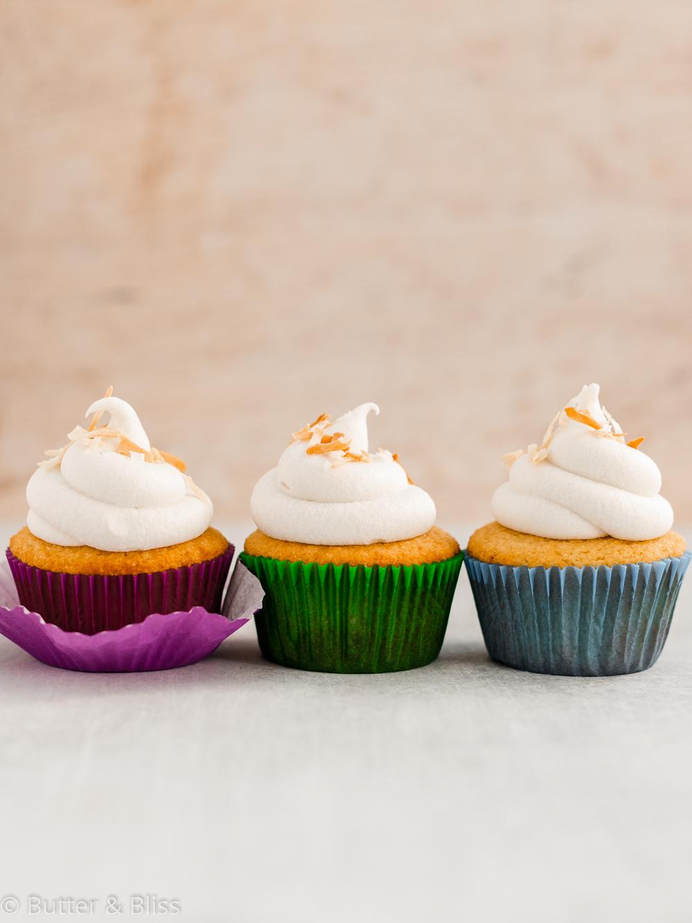 Gluten free vanilla cupcakes in a row