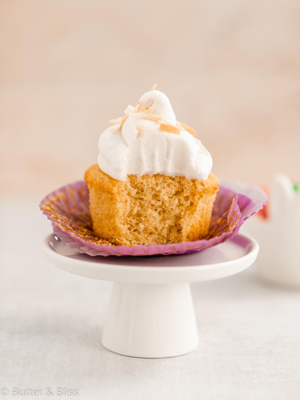 Gluten free vanilla cupcake with a bite