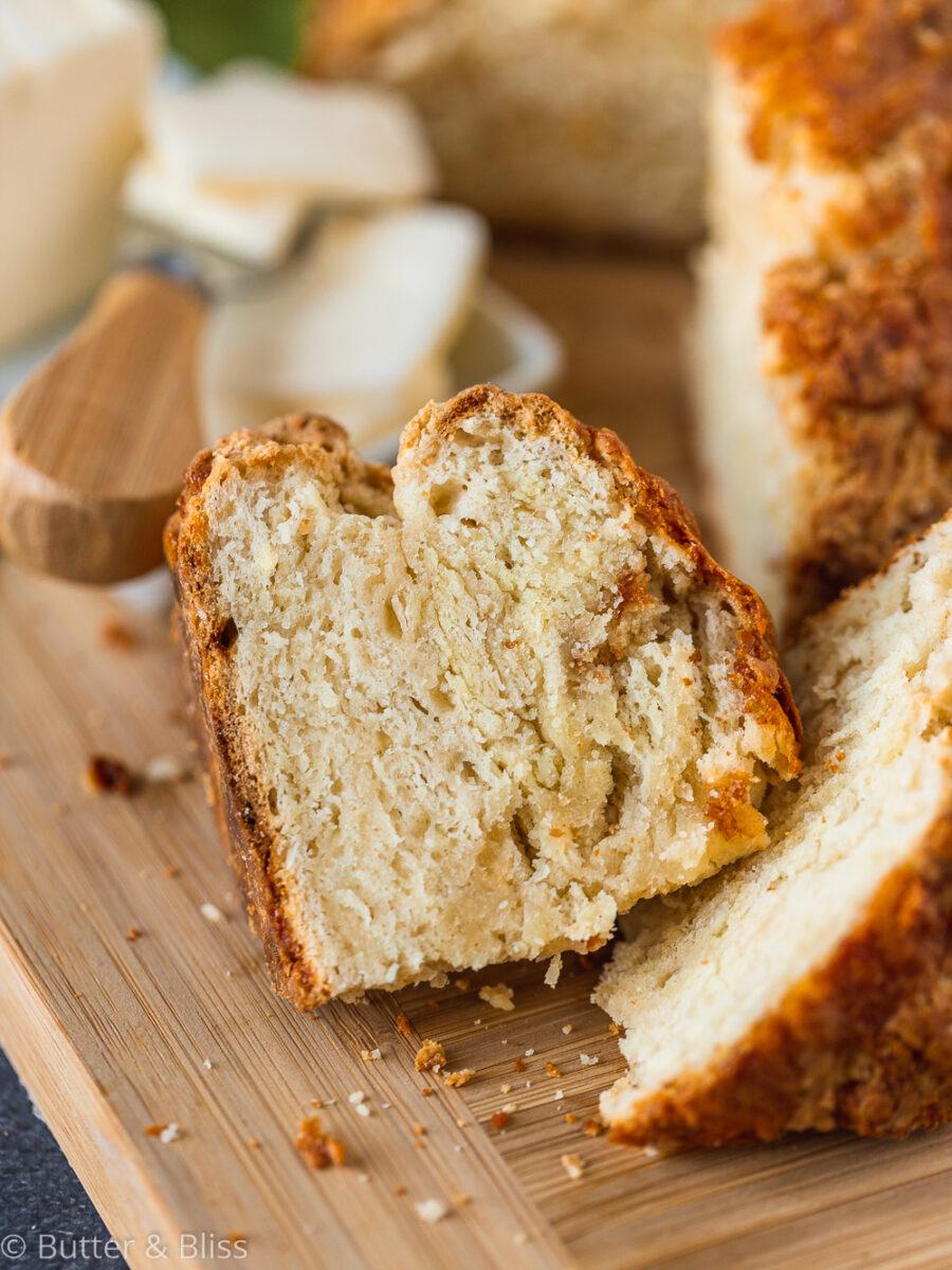 Slice of irish soda bread on cutting board