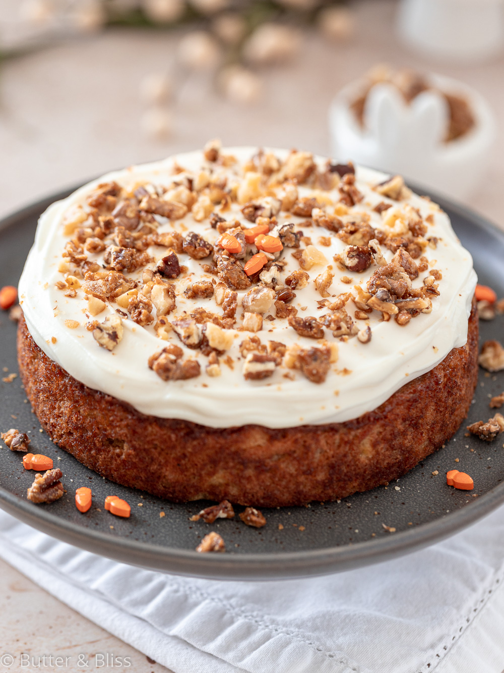 Frosted carrot cake on a serving platter