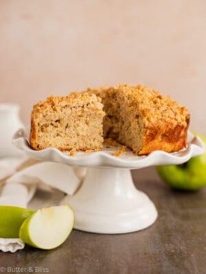 Freshly baked apple cake on a platter