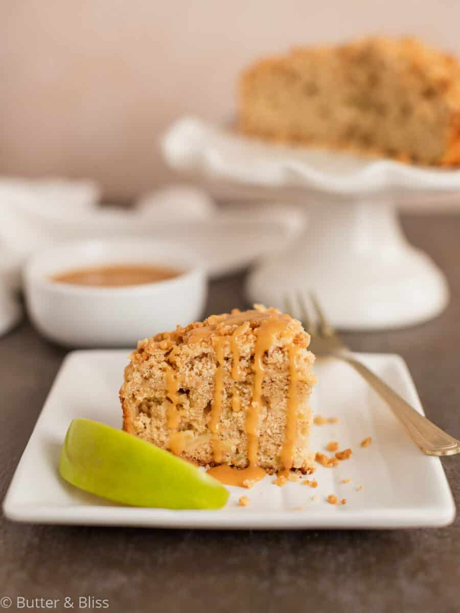 Apple cake with streusel topping on a plate