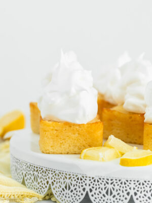 Frosted lemon cakes on a cake stand