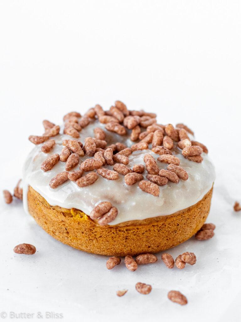 Single pumpkin donut with cream glaze