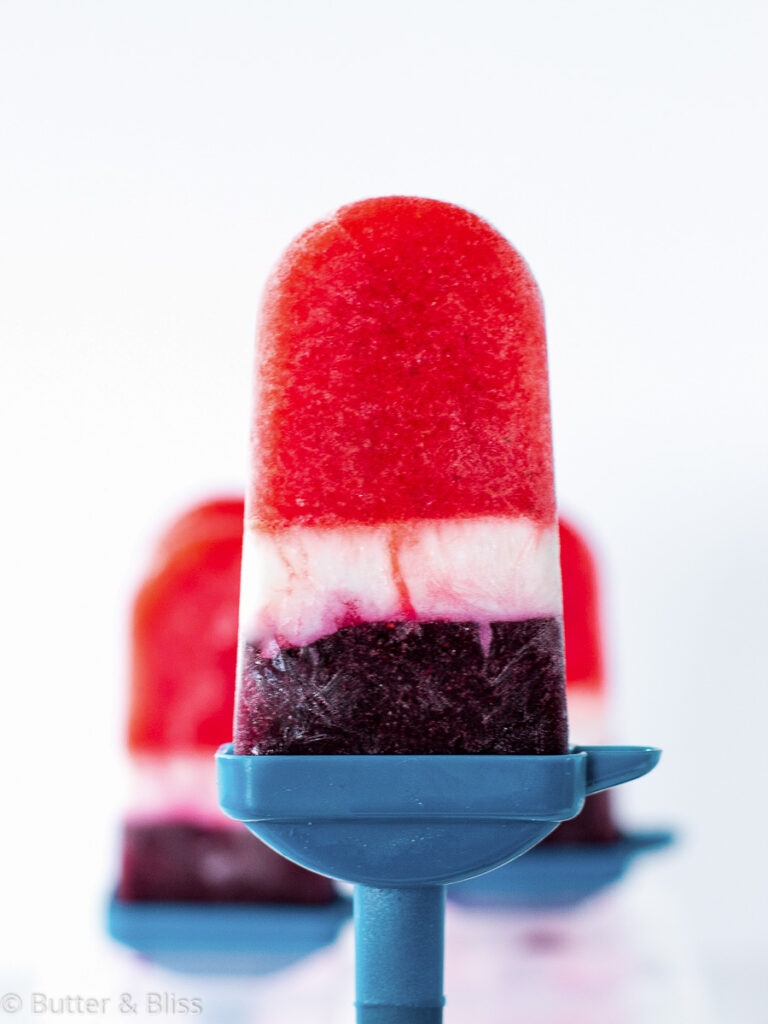 Close up of a red white and blue popsicle