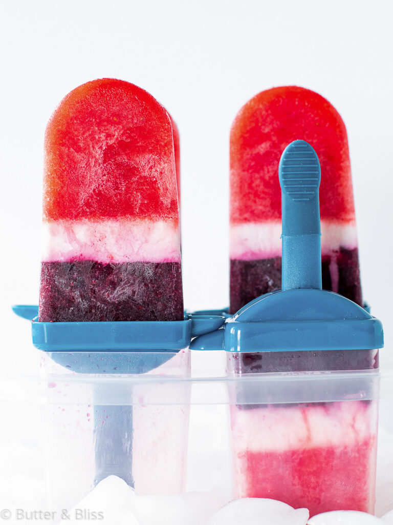 Layered sparkling berries and cream popsicles