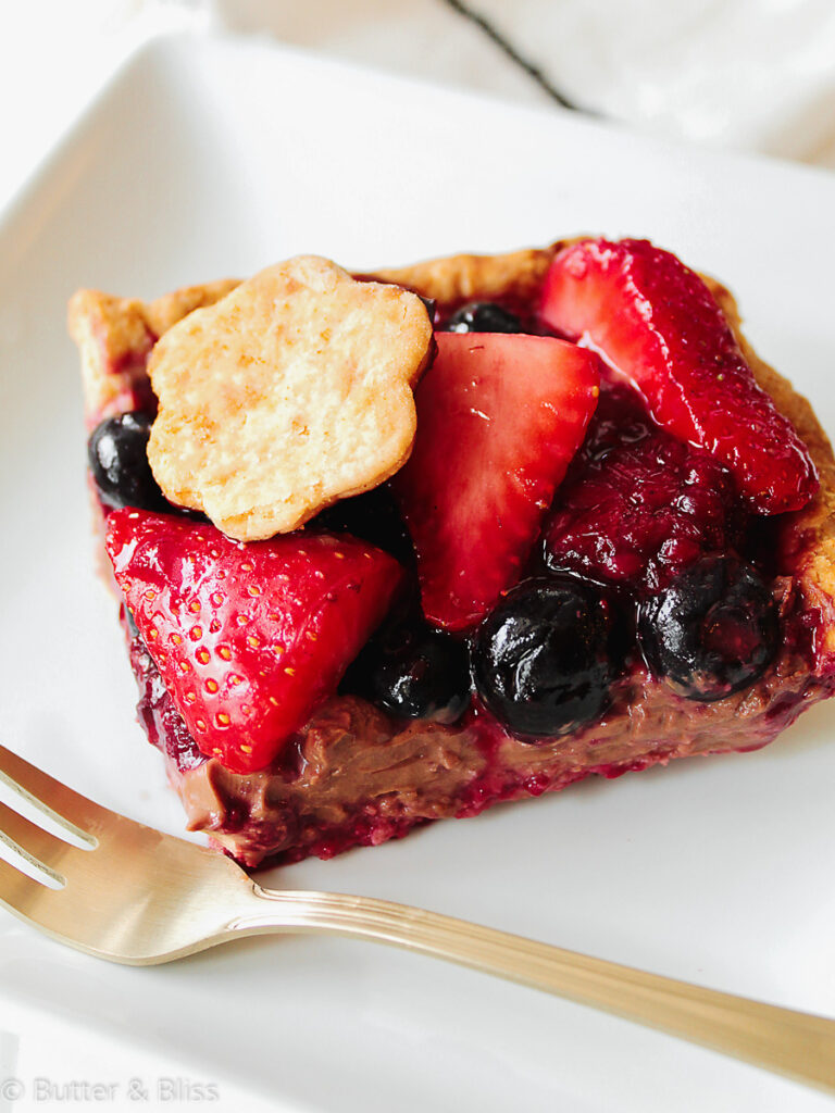 Piece of berry slab pie on a plate