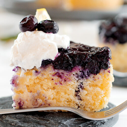 Slice of blueberry upside down cake on a plate