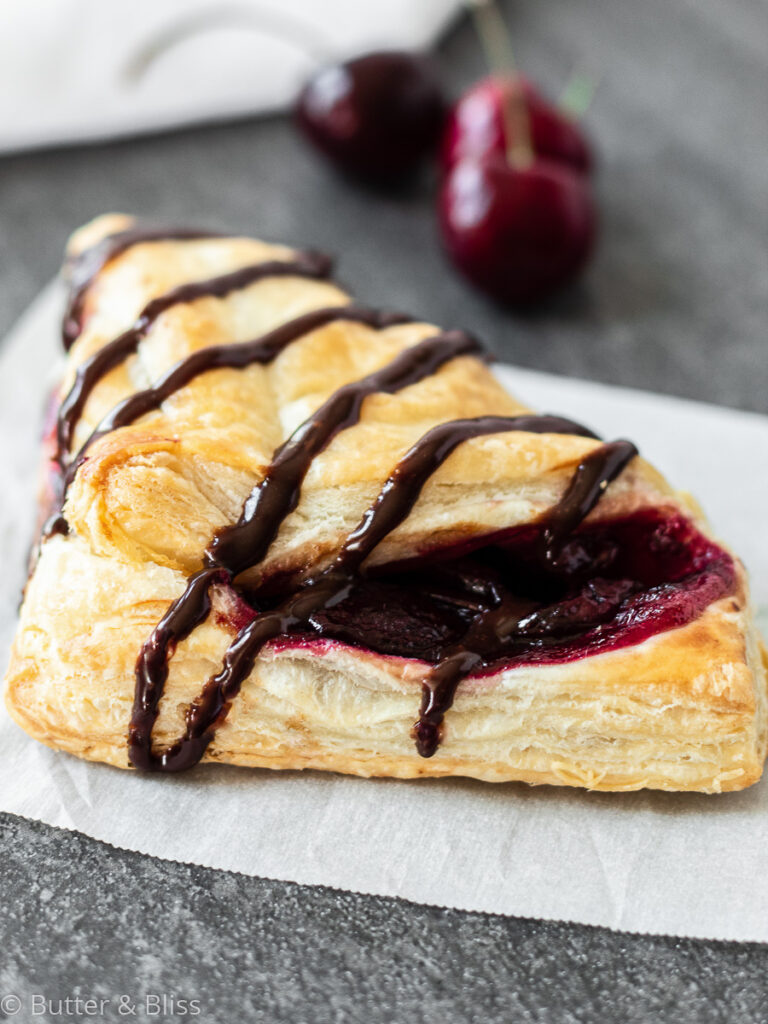 Cherry turnover with chocolate drizzle