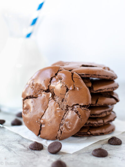 Flourless chocolate cookie stack with milk
