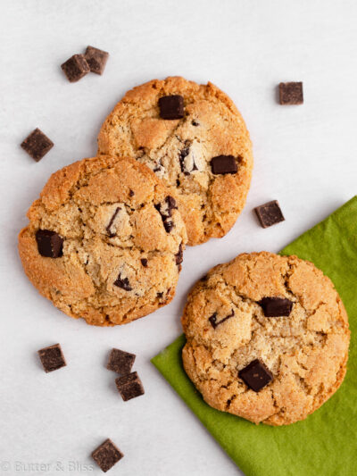 Chocolate chip cookies on a table with napkin