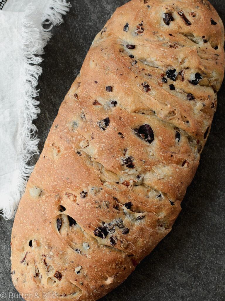 Kalamata bread loaf on a table