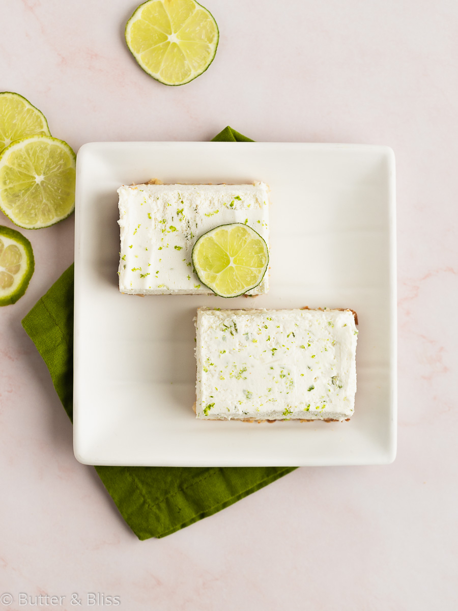 Two key lime bars on a plate