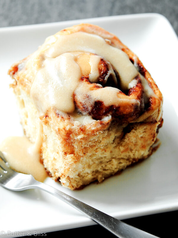 Maple glazed cinnamon roll on a plate