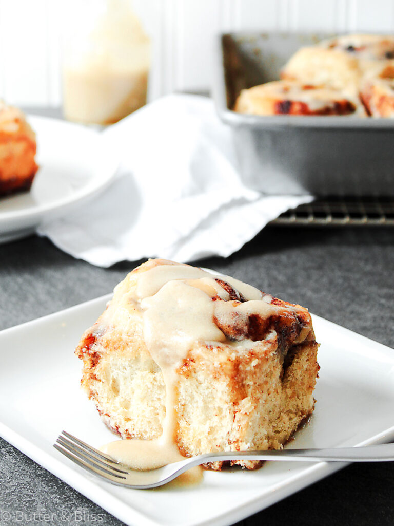 Single cinnamon roll with maple syrup glaze