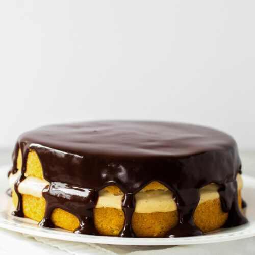 Boston cream pie cake on a platter