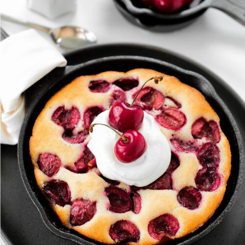 Mini cherry skillet cake with whipped cream