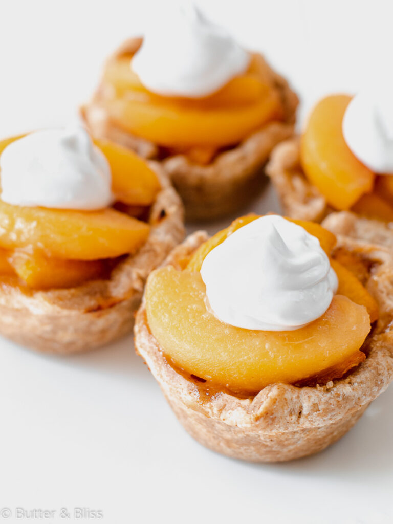 Peaches and cream mini pies on a plate