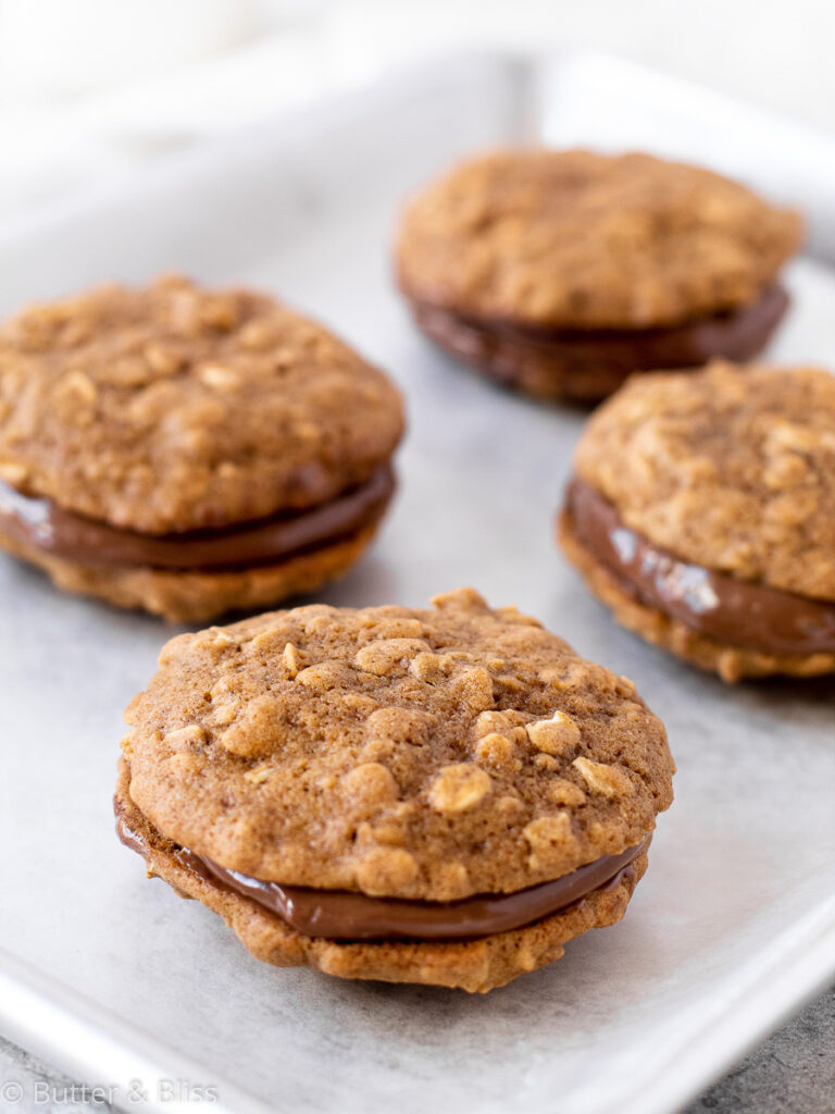 Oatmeal cookie wit nutella filling on a baking sheet