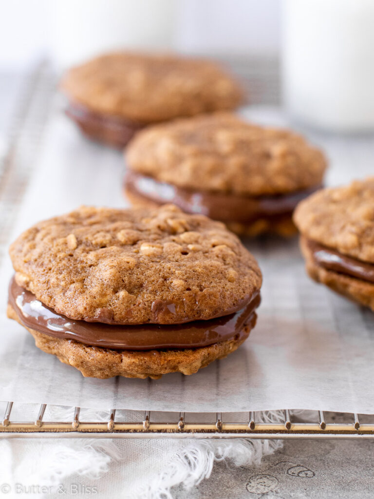Oatmeal cookie sandwiches on a cooling rack