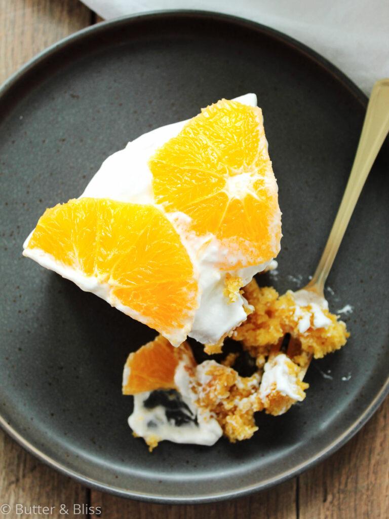 Single slice of orange olive oil cake on a plate