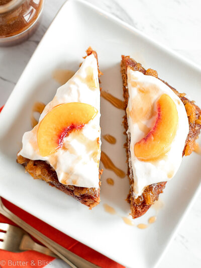 Two slices of peach caramel cake on a plate