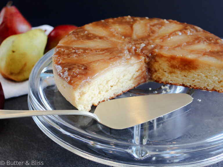 Pear and ginger upside down cake on a cake platter