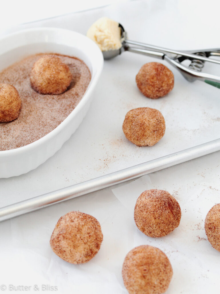 Snickerdoodle dough balls rolled in sugar