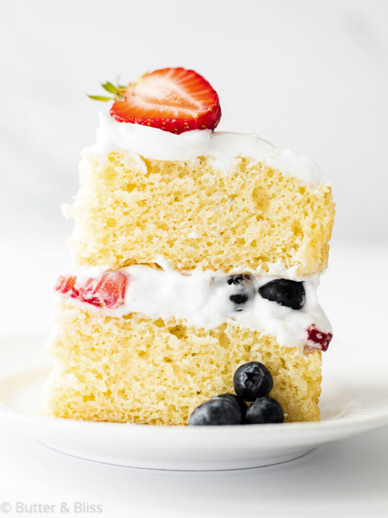 Fresh berry and vanilla cake slice on a plate