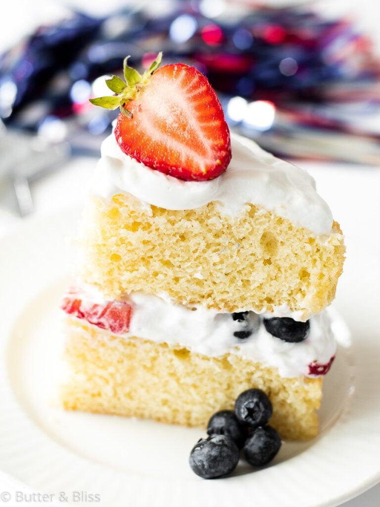 Slice of layered vanilla and berry cake