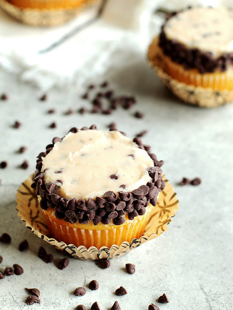 Vanilla cupcake with chocolate chips on a table