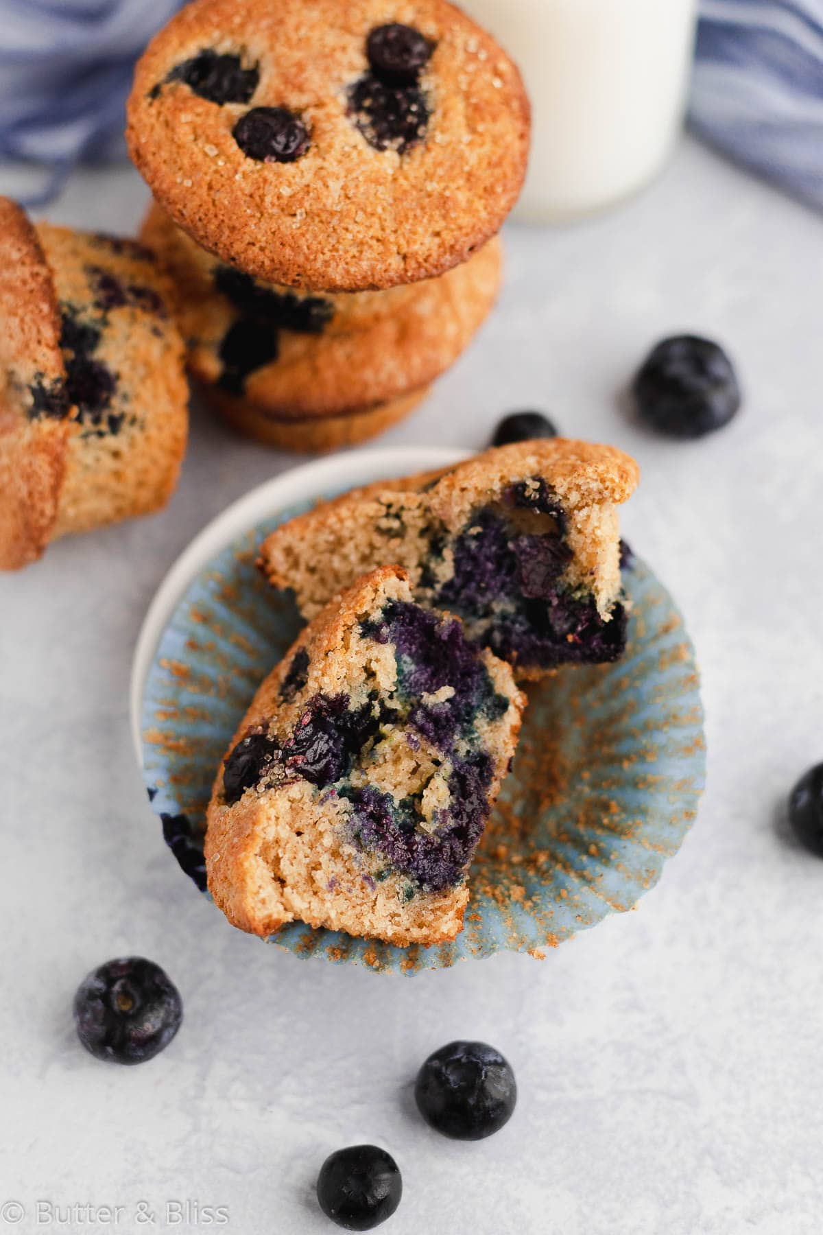 Split open blueberry muffin in a muffin liner